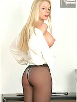 Cute Blonde Secretary In Business Suit And Black Pantyhose