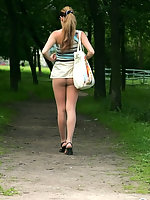 Horny chick in barely visible pantyhose eagerly spreading her legs outdoors