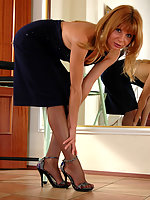 Cutie taking off her stiletto heel shoes and playing with her nyloned feet