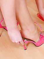 Nyloned babe taking off her pink shoes and playing with dildo any which way
