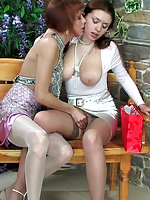 Lez girls clad in shiny nylons go for wet pussy play with a strap-on finale