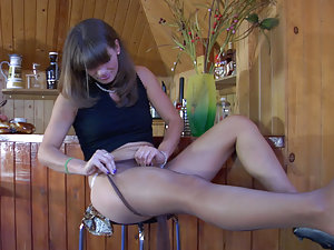 Pretty waitress changing into new suntan pantyhose after a hard working day