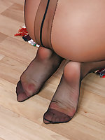 Salacious gal can�t help sniffing her tempting feet clad in black pantyhose