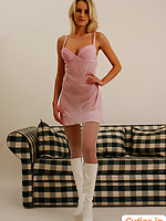 Blonde candy in boots and stockings shows pink