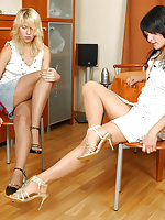 Pantyhosed babes fitting on various high heel shoes before steamy foot play