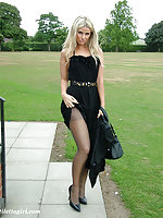 Beautiful blonde dressed in black and showing off her high heels